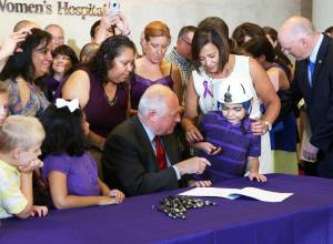 Governor Pat Quinn signing legislation earlier this month.